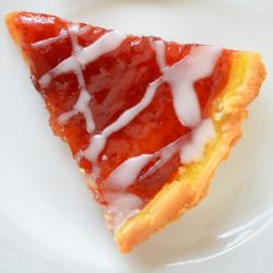 Lemon and strawberry jam tart with lemon glaze