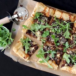 Caramelized Onion and Three Cheese Tart with Arugula Recipe