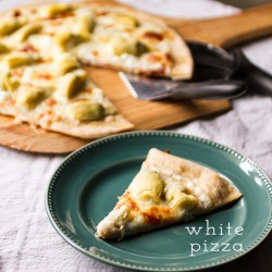 White Pizza with Bachamel Sauce Artichoke Hearts and Feta Cheese Recipe