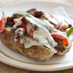 Loaded Philly Cheesesteak Baked Potatoes Recipe
