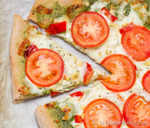 Ricotta pesto pizza with roasted red peppers