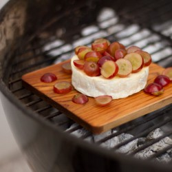 Smoked Brie cheese with Red Grapes