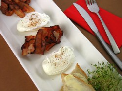 Poached eggs with bacon ribbons