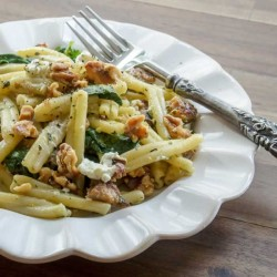 Strozzapreti Pasta with Fava Bean Greens Pesto, Spicy Italian Sausage