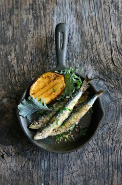 Baked Sardines with Kale Pine Nuts and Raisins