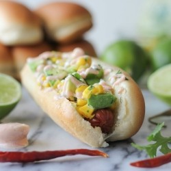 Mexican Hot Dogs with Avocado Corn Salsa and Chipotle Cream Drizzle