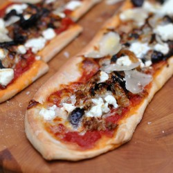 Pizza with Ground Goat Goat Cheese Onions and Olives