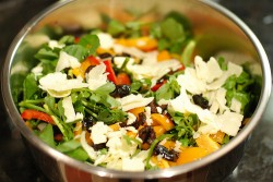 Watercress salad with red pepper black olives tomatoes cheddar and tarragon vinaigrette