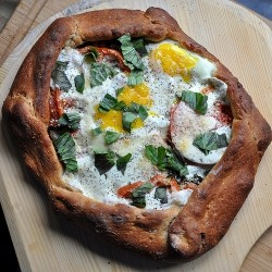 Egg Topped Pizza with Tomatoes and Kale