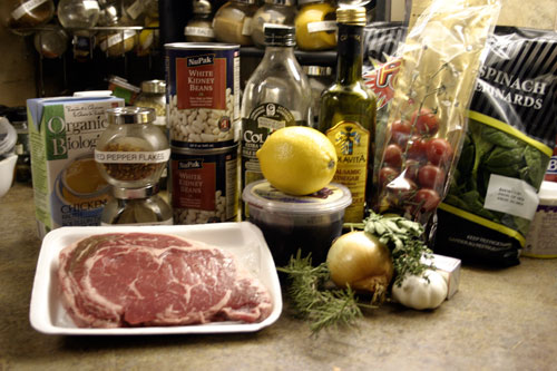 Rib Eye Steaks with Olive Oil Poached Tomatoes