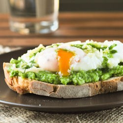 Crostini with Peas Poached Eggs and Parsley Oil