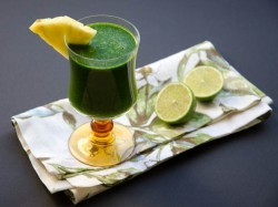 Tropical Green Juice with Spinach Mango Pineapple and Lime