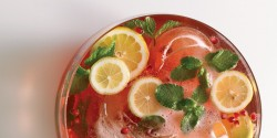 Pomegranate Champagne Punch with White Rum Lemon and Mint