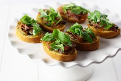 Sweet Potato Crostini with Prosciutto Fig Arugula
