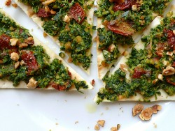 Wholemeal Pizza with Rocket Pesto Hazelnuts and Sundried Tomatoes