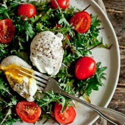 Breakfast Salad with Kale Tomatoes and Poached Egg