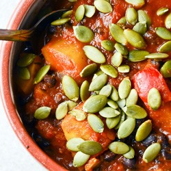 Squash and Black Bean Chili with Roasted Pumpkin Seeds